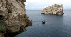 Alghero - Sardinia & x28; Italy& x29; Neptune's grotta - panorama- skott av Royaltyfri Foto