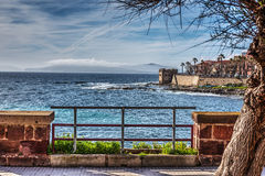 Alghero seafront under a cloudy sky Royalty Free Stock Photography