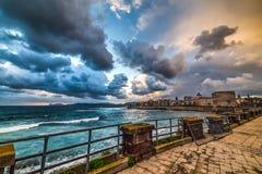 Alghero seafront under a cloudy sky Stock Photos