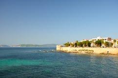 Alghero seafront. Alghero view from the Mediterranean Sea. Sardinia, Italy Royalty Free Stock Photos