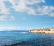 Alghero shoreline under clouds Royalty Free Stock Photos