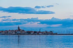 Alghero under a blue sky at sunset Royalty Free Stock Images