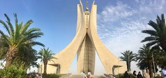 ALGIERS, ALGERIA - AUG 04, 2017: The Maqam Echahid monument. Opened in 1982 for 20th anniversary of Algeria independence built in. The shape of three standing royalty free stock photography