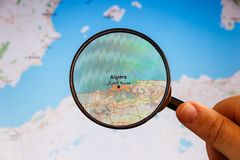 Algiers, Algeria. Political map. City visualization illustrative concept on display screen through magnifying glass in the hand stock image