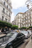 ALGIERS, ALGERIA - SEP 24, 2016:French colonial buildings in Algiers Algeria.Buildings are being renovated by Algerian government. Time by time stock photography