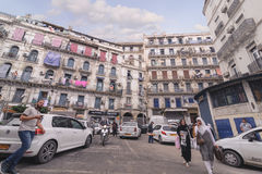 ALGIERS, ALGERIA - SEP 24, 2016:French colonial buildings in Algiers Algeria.Buildings are being renovated by Algerian government. Time by time stock image