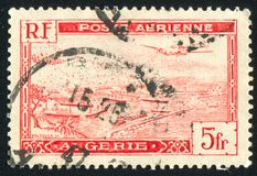 Algiers Harbor. ALGERIA CIRCA 1946: stamp printed by Algeria, shows Plane over Algiers Harbor, circa 1946 stock photo