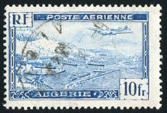 Algiers Harbor. ALGERIA CIRCA 1946: stamp printed by Algeria, shows Plane over Algiers Harbor, circa 1946 royalty free stock images