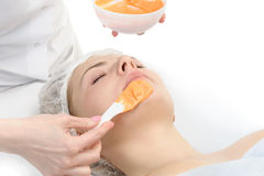 Alginate facial mask applying Stock Photo