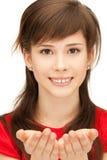Algo en la palma Imagen de archivo libre de regalías