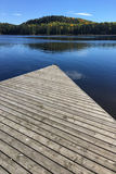 Algonquin dock and lake in fall Stock Photos