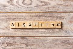 Algorithm word written on wood block. Algorithm text on table, concept stock image