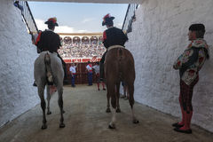 Alguaciles on horseback iin the alleywaiting for the order to open the door from the Bullring to start the show Royalty Free Stock Images