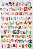 Algum alfabeto colorido do jornal imagem de stock