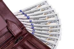 Algumas cem notas de dólar em uma carteira Foto de Stock
