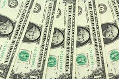 Algumas contas em um fundo do dólar americano Fotografia de Stock Royalty Free