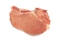 Algumas costeletas de carne de porco frescas na placa preta Imagem de Stock