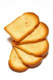 Algumas fatias de pão brindado no fundo branco Fotografia de Stock