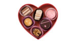 Algumas trufas em heart-shaped Fotografia de Stock Royalty Free