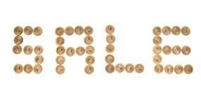 Algunas monedas como palabra ?venta? Imagen de archivo