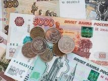 Algunas monedas están en denominaciones grandes Foto de archivo libre de regalías