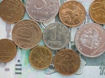 Algunas monedas están en denominaciones grandes Imagen de archivo