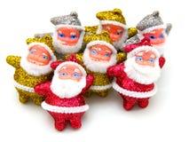 Algunas muñecas de Papá Noel son juntas Imagen de archivo libre de regalías