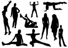algunas mujeres y un hombre que hace al gimnasta Imágenes de archivo libres de regalías