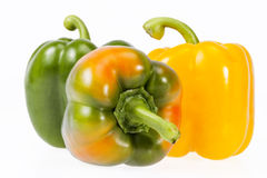 Algunas verduras de la pimienta amarilla y verde aislada en el fondo blanco Imagen de archivo libre de regalías