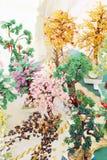 Alguns amuletos bonitos coloridos das árvores de grânulos Fotografia de Stock Royalty Free