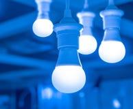 Alguns conduziram a ciência das lâmpadas e o fundo claros azuis da tecnologia Imagem de Stock Royalty Free