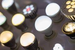 Alguns conduziram a ciência das lâmpadas e o fundo claros azuis da tecnologia Fotos de Stock