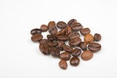 Alguns feijões de café Foto de Stock Royalty Free