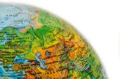Alguns mercadorias no mapa do mundo Fotografia de Stock Royalty Free