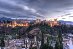 The alhambra. Palace at twilight, in granada (spain), with sierra nevada mountains in the background Royalty Free Stock Image