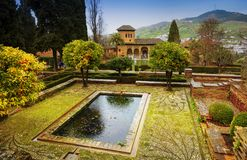 Alhambra - ancient arabic fortress , Granada, Andalusia, Spain. Spain, Andalusia / Granada - March 17, 2018: Alhambra - ancient arabic fortress and royalty free stock image