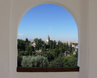 Alhambra through arch window. Islamic architecture Royalty Free Stock Photo