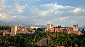 Alhambra castle in Andalusia in the early evening. Beautiful summer view on Alhambra castle up the green hill under cloudy sky, Andalusia, Spain stock footage