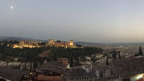 The Alhambra. The city of granada protected and guarded by the towers of the monumental and majestic castle with its vigilant towers day and night, the Alhambra Royalty Free Stock Photography