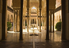 Alhambra Columns and Floor. The Alhambra (Arabic: Al Hamra; literally the red) is a palace and fortress complex of the Moorish monarchs of Granada, in southern Royalty Free Stock Photos