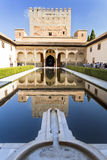 Alhambra Court of the Myrtles South Portico. Tourists visiting the Court of the Myrtles with the south portico and Tower of Comares reflected on the central pool royalty free stock photo