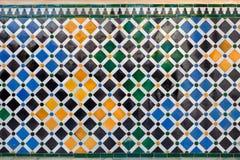 Alhambra de Granada. Ancient mosaic pattern. Ancient mosaic pattern in Nazaries Palace, Granada, Spain Royalty Free Stock Photo