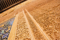 Alhambra de Granada. Detail of the intricate patterns on a wall of the Alhambra Palace in Granada, Spain Royalty Free Stock Image