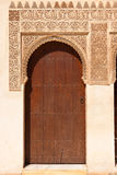 Alhambra de Granada: Moorish ornated door. In the Court of the Mirtles (Patio de Arrayanes Royalty Free Stock Photography