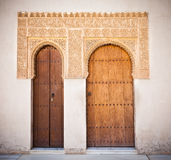 Alhambra de Granada: Moorish ornated doors. In the Court of the Mirtles (Patio de Arrayanes Stock Photo