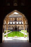 Alhambra de Granada: Patio de Arrayanes. The Court of the Myrtles seen trough a moorish door Royalty Free Stock Photos