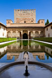 Alhambra de Granada: Patio de Arrayanes. And Torre de Comares. (Court of the Myrtles and Comares tower Royalty Free Stock Photo