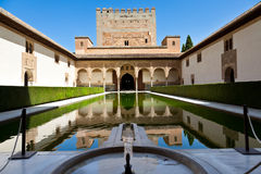 Alhambra de Granada: Patio de Arrayanes. And Torre de Comares. (Court of the Myrtles and Comares tower Royalty Free Stock Photography