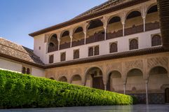 Alhambra building and gardens in Granada in Spain. Alhambra decorated building and gardens in Granada in Spain Royalty Free Stock Images