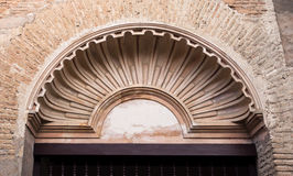 Alhambra detail of a Tympanum over Door. Tympanum in the shape of a shell at the former Franciscan Convent in The Alhambra complex, Granada, Spain Stock Image